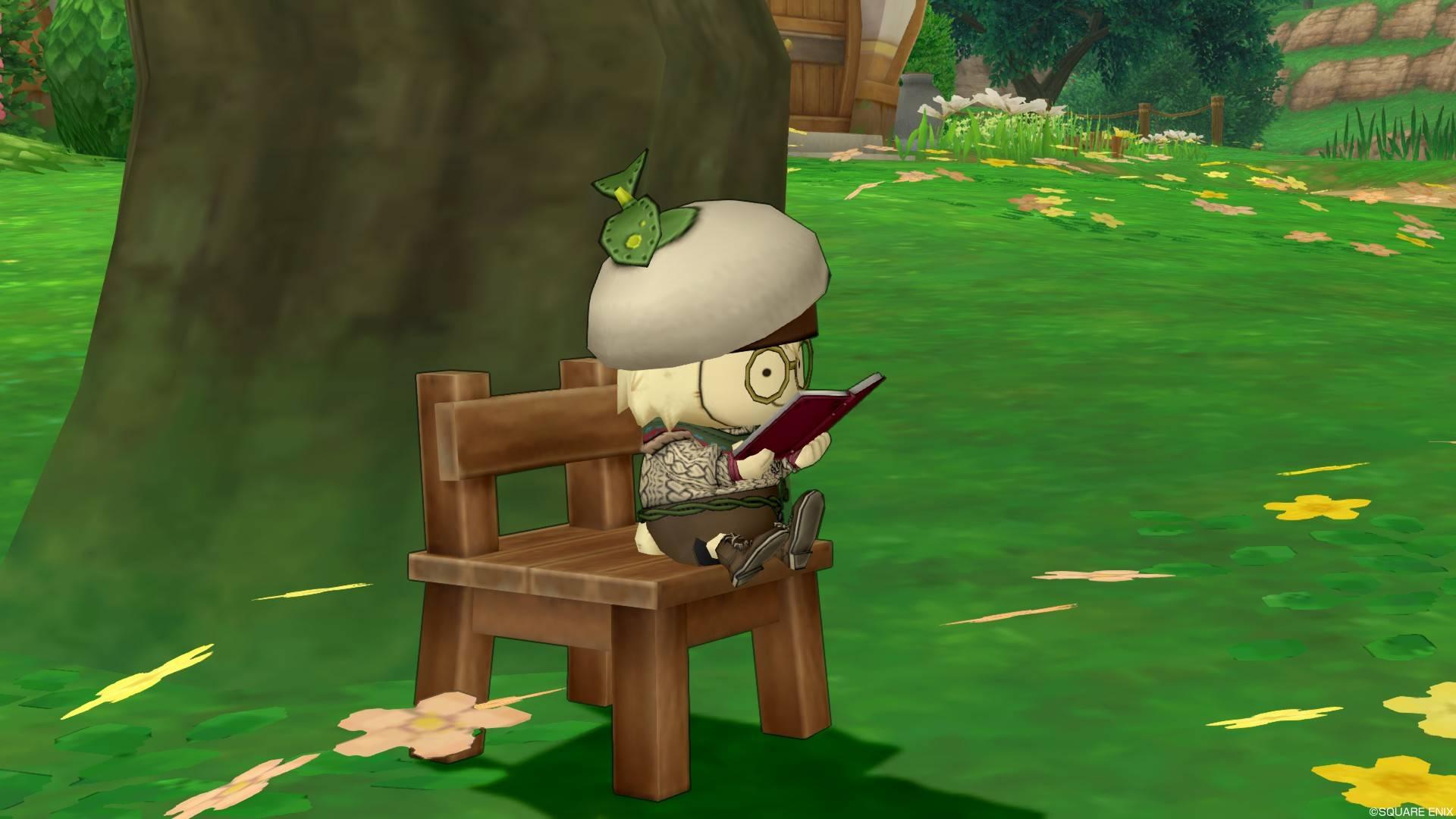 イスに座って本を読むメガネをかけたプクリポ